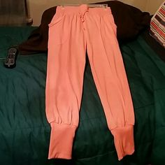 Orange peachy color jogger. Never worn New style jogger. Never worn. Wide waist band and wide ankle band. Drawstring waist. One can dress it up or down.$@le Pants Track Pants & Joggers