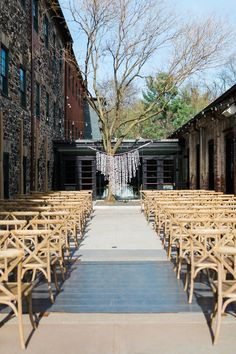 DIY paper backdrop for the bride and groom during their outdoor wedding ceremony in our couryard #weddingvenue #venues