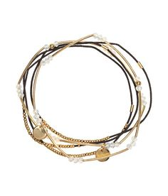 Check this out! Narrow elastic bracelets decorated with beads and pendants in metal and plastic. - Visit hm.com to see more.