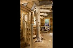 Log Cabin in the Woods Interior. My first house had a spiral stair case. I love them.