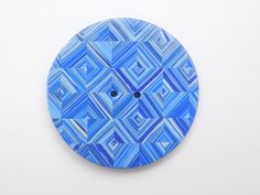 large, round polymer clay button in a beautiful blue diamond design