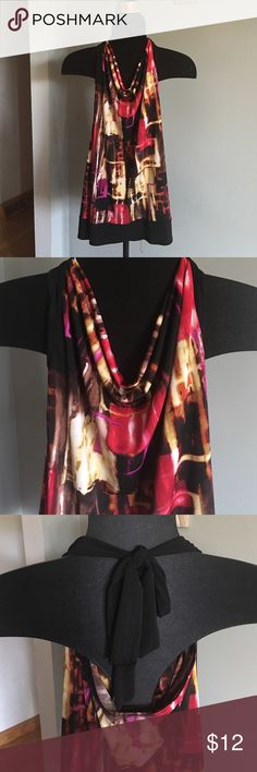 Is tie long dress tank w gold statement bracelet Long multi color tank top with a scoop neck tie neck and black band at the bottom that's non sinch.   Draped beautifully.   Gold statement bracelet with brown stones.  Magnetic clasp. iz  Tops Tank Tops