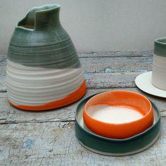 Porcelain vessels,  asymmetrical edges; orange, grey