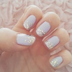 Pale blue with glitter nails