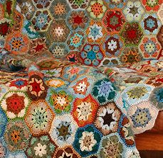 hexagonal pieces made by residents of Cape Town's Khayelietsha township then pieced together by Laura Summs, just an incredible community effort... change the world kind of stuff... check it out.