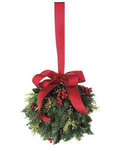 The evergreen kissing ball is a charming romantic tradition harking back to England. As the custom goes, Made of fresh holly with noble fir, incense cedar and natural red berries is hand assembled using French floral wire and a hanging ribbon. Christmas Swags, Christmas Love, Christmas Colors, Holiday Wreaths, Holiday Crafts, Christmas Decorations, Xmas, Christmas Ornaments, Christmas Ideas
