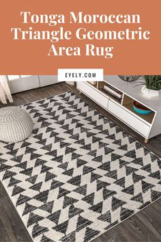 Inspired by vintage Moroccan tribal rugs, our modern version is power-loomed with a short pile. Rows of triangle symbols are woven in black on a field of ivory; the mingled threads recall traditional handwoven rugs. Add some Bohemian style to your home with this easy-care rug.