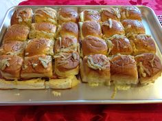 Yummy Ham & Cheese (Havarti) on Hawaiian Sweet Rolls.  Honey Mustard dressing inside the roll, layer ham & cheese.  Top with 1/4 cup butter and saute a half onion, poppy seeds, squirt of mustard & few dashes of worcestershire sauce bring to a quick boil then pour over the sandwiches. Bake 10-12 min covered then 2-3 more uncovered. OMG delish!