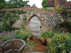 old oak door flint wall is part of Brick garden Wall - Lancet head doorway in a flint and brick garden wall Garden Entrance, Garden Doors, Garden Gates, Brick Wall Gardens, Brick Garden, Garden Wall Designs, Garden Design, Brick Archway, Country Cottage Garden