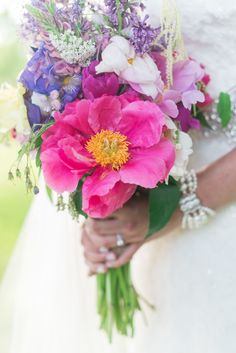 Bright pink flower wedding bouquet  Laura Kelly Photography
