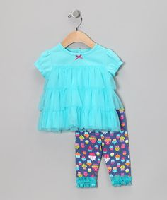 Put a spring in that little sweetie's step—or crawl—with this terrific tutu-inspired tunic. An elastic waistband makes the matching cotton leggings easy to change. Clad with ruffles, roses and a bitty bow, this outfit is bright and beautiful—just like her!Includes tunic and leggings100% cottonMachine wash; tumble dry