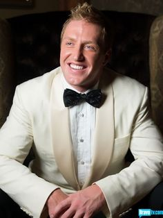 Kroy Biermann wedding day tux, classy ivory jacket with black and silver lined bow tie