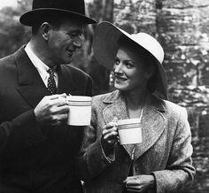 "John Wayne and Maureen O'Hara having tea in ""The Quiet Man"""