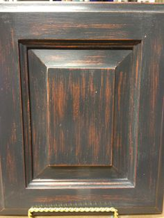 Cabinet door makeover painted with Chalk Paint® in Graphite over Copper metallic paint, then sand distressed, Clear Waxed by TLC Design Studio.