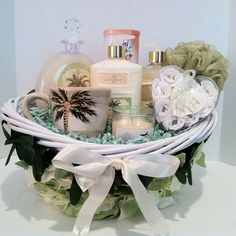 Tropical Fantasy Gift Basket Indulge in serenity in Coconut Vanilla Bean relax an wash all your stress away take yourself on a retreat you deserve it. Enjoy shower gel, bubble bath, lotion, candle, bath sponge, vanilla rose soap petal, cup, crystal light natural lemon iced tea , and with our one of a kind finest decorative design basket just for you. Vera-Mae Collection.