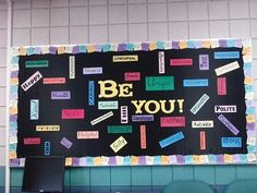 """""""Be"""" bulletin board. Border is individual post it notes with positive messages on them."""
