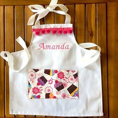 Girls personalized apron with cupcake pocket includes name!