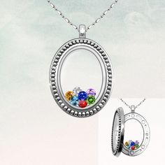 Vintage oval glass locket necklace with family birthstones inside.