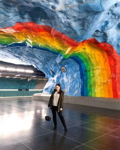 ROXANE - Travel : Discovering Stockholm's beautiful Metro Stations, where 14 have been transformed into pieces of art. This metro station rainbow art installation was my absolute favorite while discovering Stockholm's underground.