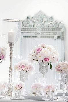 CHARMING & DELICATE. So easy to re-use finds from a thrift shop. By using a common color such as silver, than gluing silver glitter to other glass items to match.