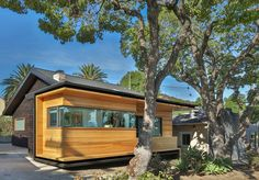 In the little-known neighborhood of Hermon, located just outside of downtown Los Angeles, a dilapidated 1920's bungalow has undergone a major remodel, bringing new life to the old structure. The new addition to the front of the house forms a unique