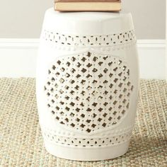 An interesting garden stool is the perfect side table.   $88