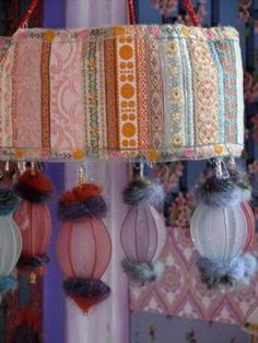 funky fun!  This would be a cool idea to use old lampshades of different shape/size and string around a play room.