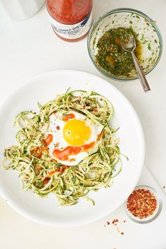Grab zucchini noodles, pesto, and an egg and you've got a lunch bowl that's sure to satisfy. Grab zucchini noodles, pesto, and an egg and you've got a lunch bowl that's sure to satisfy. Dinner For One, Sauteed Zucchini Recipes, Zucchini Noodles, Zucchini Bread, Lunch Recipes, Dinner Recipes, Summer Recipes, Huevos Fritos, Low Carb Meal Plan