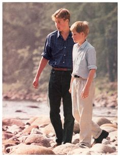 On the banks of the River Dee at Balmoral in Scotland are Princes William, age 15 and Harry, age 12 shortly after their mother, Diana died in 1997.