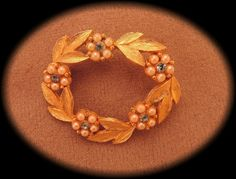Items similar to WAS 10, NOW 5! Gold Tone Wreath Pin with Seed Pearl Flowers and Blue Rhinestones 1960s on Etsy