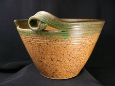 I like the idea of this as a mixing bowl, but I'd like a handle on both sides.