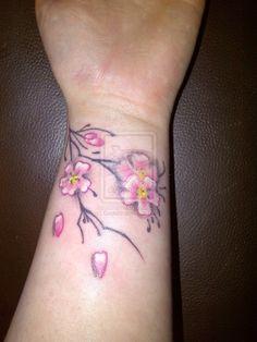 sakura_blossom__cherry_blossom__tattoo_by_dook89-d4qierx.jpg