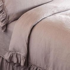 """The subtlest sort of luxury, a secret to keep to yourself and your nearest and dearest, pure linen bedding, hand-dyed and pre-washed to start the mellowing process, will grow softer with time and use. Embellished with velvet ribboned, raw-edged ruffles has natural shell button closure. Made in USA. Hand-dyed colors will vary slightly. Queen, 94""""L x 90""""W"""