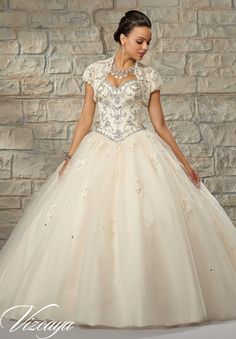 Quinceanera Gowns Style 89034: Beaded Lace Bodice with a Tulle Ball Gown Skirt.  http://www.morilee.com/quinceanera/quinceaneravizcaya/89034