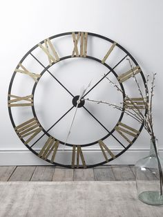 With a rustic aged metal wrought iron frame, our oversized and vintage inspired clock includes contract painted roman numerals and classic white metal hands. This weighty skeleton clock can be easily hung with the metal loop on reverse, but looks just Plywood Furniture, Furniture Design, Furniture Storage, Chair Design, Design Design, Modern Furniture, Home Decor Accessories, Decorative Accessories, Big Wall Clocks