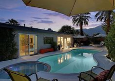 Palm Springs Retreat for In evening, the mountains turn deep purple and the house lights cast a warm glow on the water - Turnkey Vacation Rental Palm Springs Vacation Rentals, Private Pool, Mountain View, Deep Purple, View Photos, Lighthouse, Glow, Swimming, California