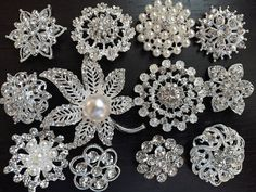 50% off price for a limited time only!  This listing is for 12 pieces of Assorted High Quality Sparkling rhinestone pearl button/brooch embellishments. Perfect for your Craft DIY Supplies! A few pieces may be substituted with ones with similar design and size, if the original ones are out of stock. Free shipping for any additional sets.  Size (approx): range from 1 to 2 (25mm to 50mm). Material: metal base with clear rhinestones and/or off-white/ivory color pearls. Color: silve...
