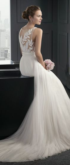 Wedding dress with sheer leaf detail