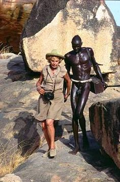 Leni Riefenstahl with Nuba tribesman.  After her propaganda films for the nazis, she redirected her focus to black men in another continent.