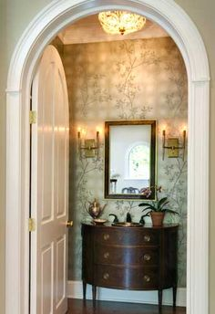 Powder room. Love the arched door. Leslie Hayes Interiors.