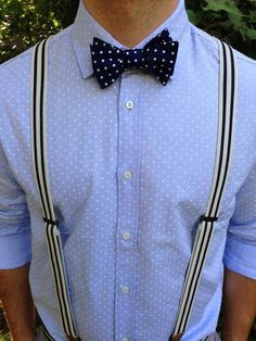 Make a light blue polka dot dress shirt your outfit choice for a sharp, fashionable look.   Shop this look on Lookastic: https://lookastic.com/men/looks/light-blue-polka-dot-dress-shirt-navy-and-white-polka-dot-bow-tie-white-and-black-vertical-striped-suspenders/18520   — Navy and White Polka Dot Bow-tie  — Light Blue Polka Dot Dress Shirt  — White and Black Vertical Striped Suspenders