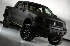 2012 Lifted matte black Ford truck. www.CustomTruckPartsInc.com is one of the largest Truck accessories retailer in Western Canada #CustomTruckParts #pickups #pickuptruck Custom Truck Parts