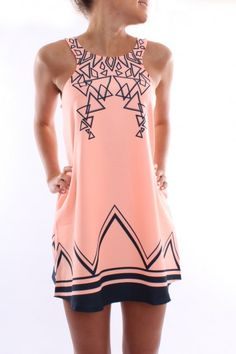 Love the neck of the dress and the triangle designs. I have never own anything this shade of pink. LOVE! - Makelifeyourrunway.blogspot.com