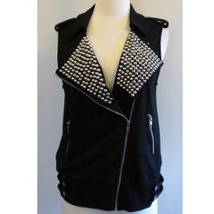 Forever 21 Studded Moto Vest NWOT Forever 21 black studded Moto vest. Asymmetrical zip closure, 2 front zip pockets, silver studs and hardware, stretchy material, button tabs at shoulders and hem. Size M. Brand new without tags. ❌ NO TRADES ❌ NO LOWBALLING ❌ Forever 21 Jackets & Coats Vests
