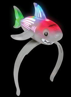 "Shark LED Headband by Rinco. $9.99. Our Shark LED Headband is a great party favor to hand out at night time celebrations.  This also makes a great carnival prize.  Hand this out to your guests at luau parties, beach parties, or summer swimming parties.One size fits allBatteries includedSize"" 9"""