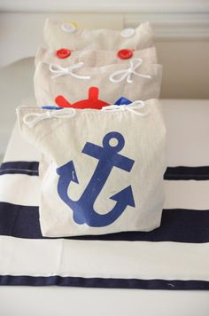 Favor bags with boat bath toys, fish straw, and bath squirts  1st birthday- boy - Kara's Party Ideas