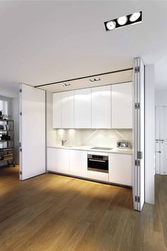 Lower kitchen-- i like the idea of hiding it behind the doors. Xila kitchen with anthea door system by Boffi