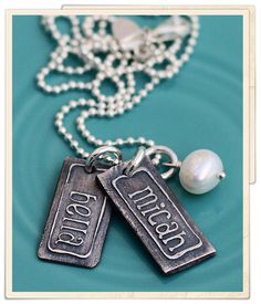 These vintage names charms are hand sculpted out of fine silver.