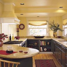 a galley kitchen; I like the ceiling and wall light color and the lower dark color; it weights the kitchen nicely