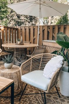 Light synthetic wicker makes the Tula ready to withstand a tropical storm or a typical Nor-easter. A Lily White weather-proof cushion needs a little more TLC (please don't leave it in the rain!) but promises to keep your butt dry and cozy for seasons to come. Photo by Brianne Penney. #OutdoorDecor #BohoPatio #PatioIdeas